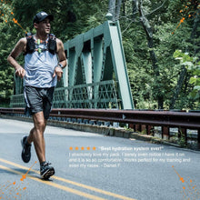 Load image into Gallery viewer, orange mud HydraQuiver Vest Pack 1 man running
