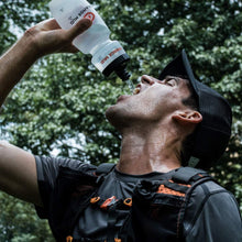 Load image into Gallery viewer, orange mud HydraQuiver Vest Pack 1 man drinking