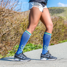 Load image into Gallery viewer, lily trotters compression socks om woman running