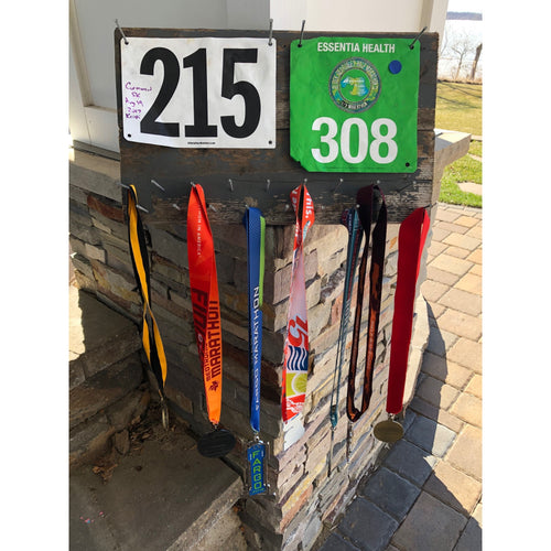 reclaimed wood race medal and bib holder by run uncommon