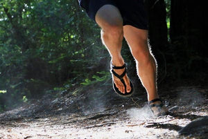 shamma sandals running feet leaping off ground in sandals