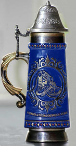 antique beer stein bottle opener with profile view