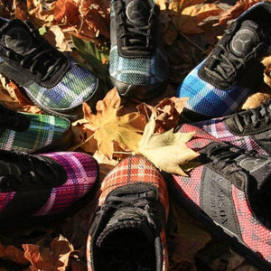 trail racing shoes in pile of colorful leaves