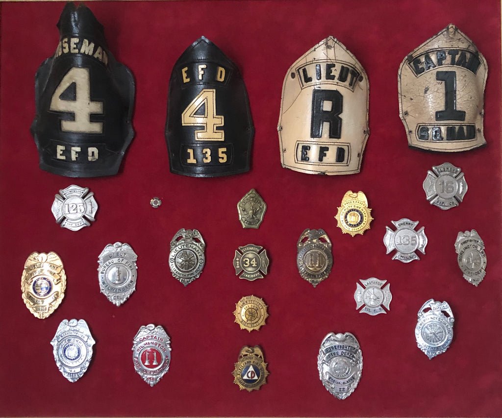 A large assortment of firefighter badges