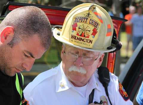 Chief Allen Huelsenbeck of Wilmington Delaware Fire Department speaking with a fellow firefighter on scene of a call.