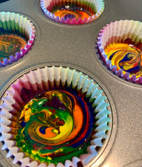 Using a toothpick or wooden skewer swirl melted crayons