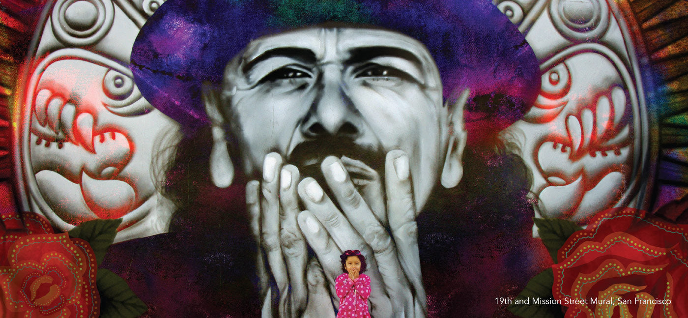 Young girl standing in front of large mural of Carlos Santana and mimicking Santana holding his hands to his mouth