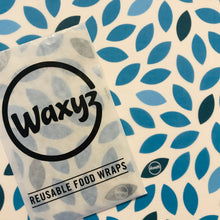 Load image into Gallery viewer, Waxyz wraps by Bplasticfree in blue leaf design.