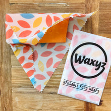 Load image into Gallery viewer, keeping cheese fresher for longer with orange leaf reusable waxyz wraps