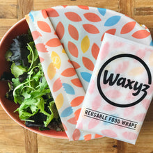 Load image into Gallery viewer, keeping food fresher for longer with a Waxyz wax wrap in orange leaf design. An eco and vegan friendly alternative to cling film.