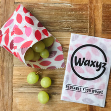Load image into Gallery viewer, A sandwich wrap in red leaf by Waxyz. A reusable plastic free alternative to cling film.