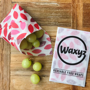 A sandwich wrap in red leaf by Waxyz. A reusable plastic free alternative to cling film.