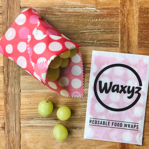 Reusable red dotty Waxyz food wrap for keeping food fresher for longer