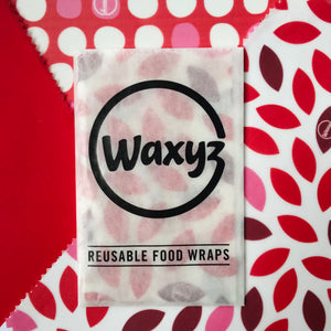 Waxyz wraps triple pack in red designs