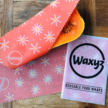 Load image into Gallery viewer, Orange Daisy Waxyz keeping food fresher for longer by Bplasticfree,