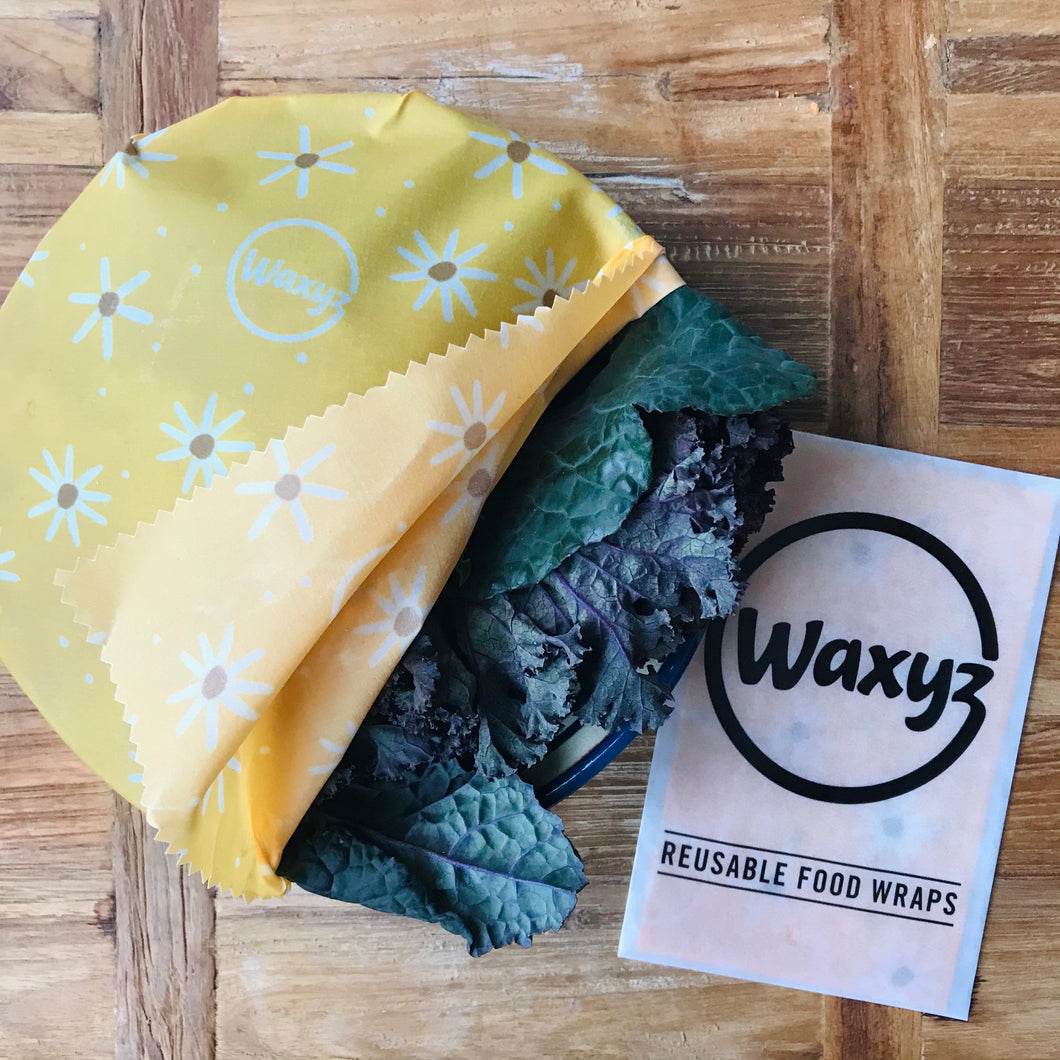 Yellow daisy waxyz sandwich and food wraps. A reusable wax wrap to keep food fresher for longer.