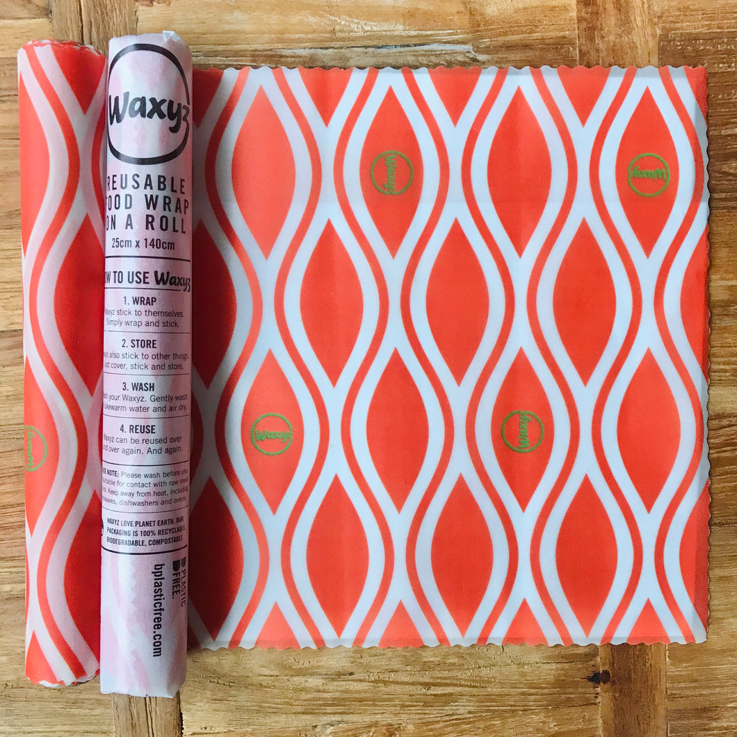 Orange Waxyz reusable food wrap by Bplasticfree. An eco friendly alternative to cling film. Help save the planet