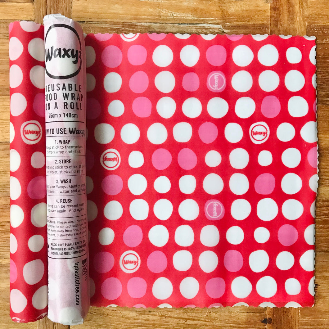 Red dotty reusable wax wrap on a roll by Bplasticfree.