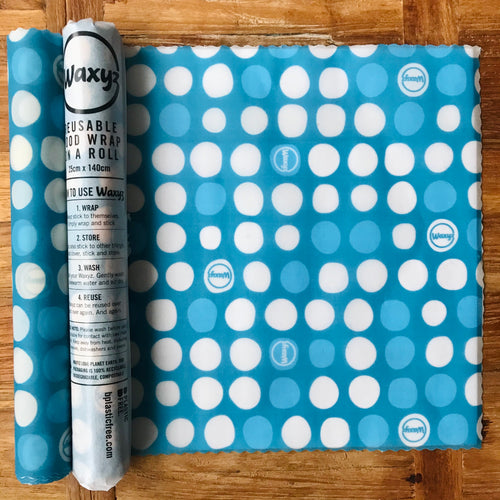 Blue dotty Waxyz food wrap on a roll. An eco and vegan friendly alternative to cling film to help save our planet.