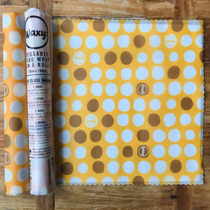 Yellow Dotty Waxy wrap on a roll. Cut to size and reuse again and again to keep food fresher for longer