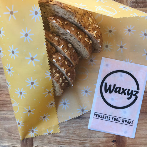 Extra Large reusable food wrap in yellow daisy design by Waxyz. A plasticfree alternative to cling film.