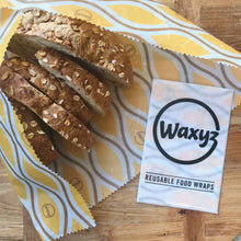 Load image into Gallery viewer, Waxyz extra large wrap in yellow daisy for keeping bread and food fresher for longer.