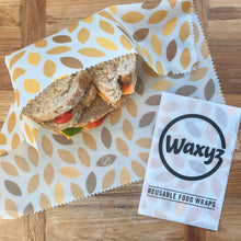 Load image into Gallery viewer, yellow leaf sandwich wrap by Waxyz to keep sandwiches fresher for longer