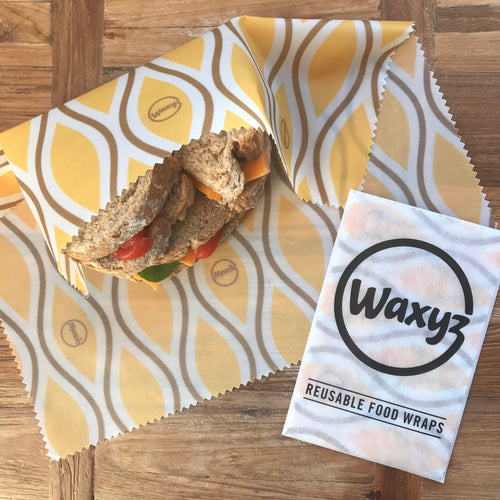 Large sandwich wrap in yellow diamond. A waxyz reusable wax wrap which is eco and vegan friendly.