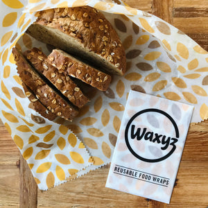 Yellow leaf Waxyz reusable wax food wrap which is plastic free.