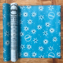Load image into Gallery viewer, Blue Daisy Waxyz wax wrap on a roll