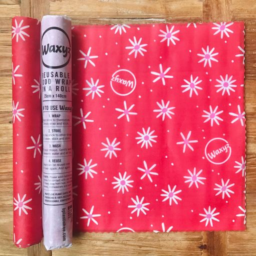 Reusable wax wrap on a roll by Waxyz in daisy red