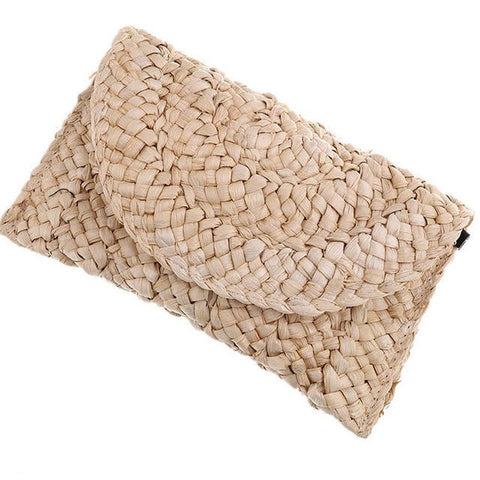 Handwoven straw and rattan clutch purse