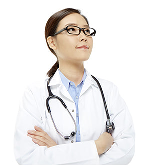 Doctor looking up with crossed arms