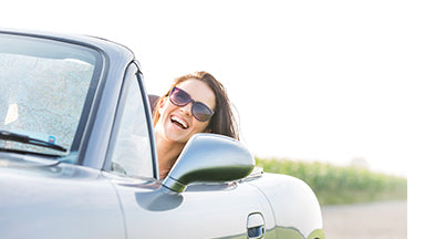 Woman driving happily