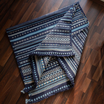Kharad rug with intricate tapestry and indigo accents