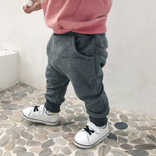 Playful Cartoon Tongue Joggers