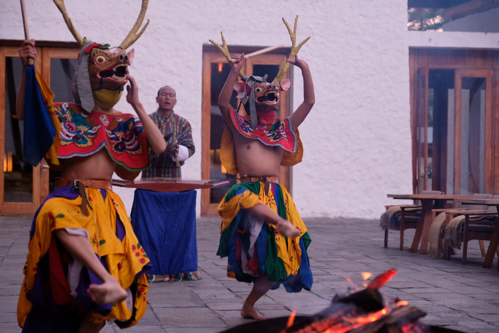 Traditional Bhutanese dance performance in winter