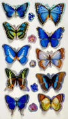 10 sparkling 3D butterfly stickers, in shades of blue, orange, brown and white.