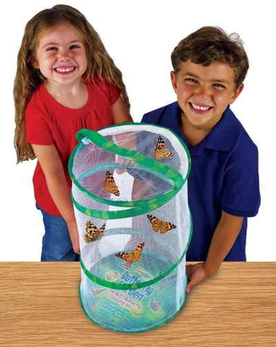 2 smiling children enjoying the 5 orange and black butterflies flutter inside 18-inch tall green pop-up mesh habitat.