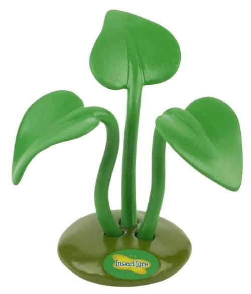 Plastic green 3-pronged stand with green leaves for holding praying mantis egg case.