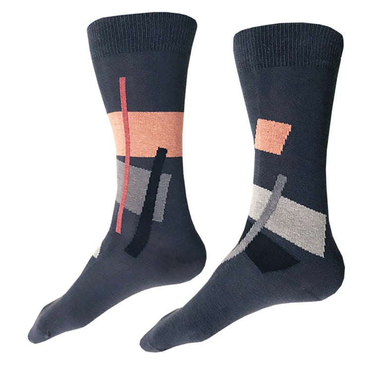 MADE IN USA men's dark grey cotton socks by THIS NIGHT with grey, black, light grey, salmon, and rose abstract geometric pattern