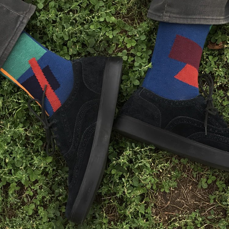 MADE IN USA men's blue cotton socks by THIS NIGHT with abstract-art inspired pattern with teal, yellow, orange, navy, and burgundy