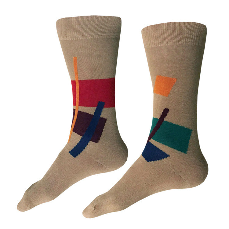 MADE IN USA men's tan cotton socks with abstract geometric pattern in reddish-orange, yellow, teal, burgundy, and blue