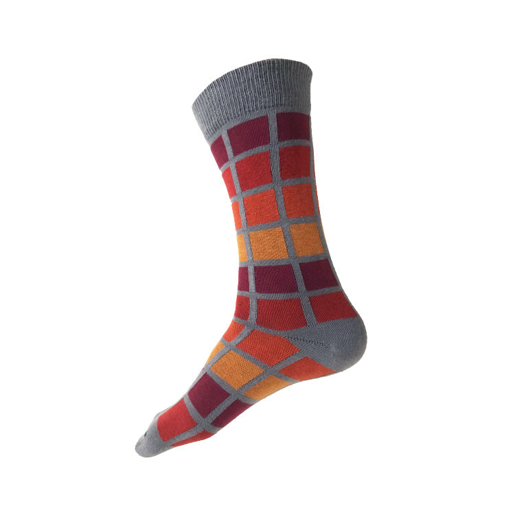 MADE IN USA men's grey geometric cotton socks with maroon, paprika, orange, yellow-orange pattern inspired by the R62A NYC Subway Car