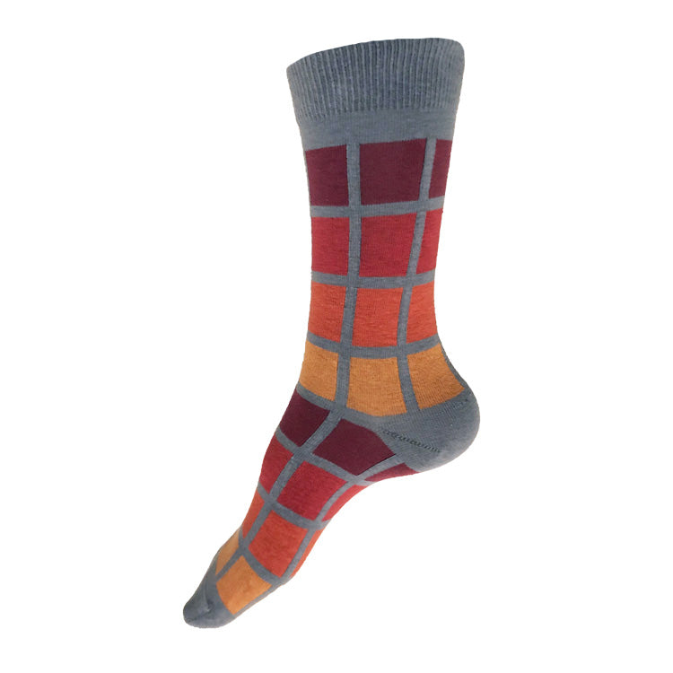 MADE IN USA women's grey geometric cotton socks inspired by R62A NYC Subway car with maroon, paprika, orange, + yellow-orange pattern