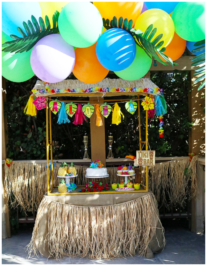 summer party luau bright color balloons decorations greenery