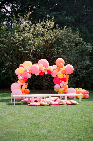 outdoor balloon garland garden party arch