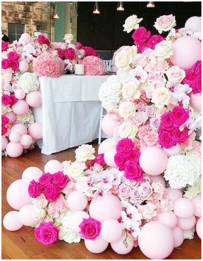 balloons flowers florals arch garland table setting overflow pink