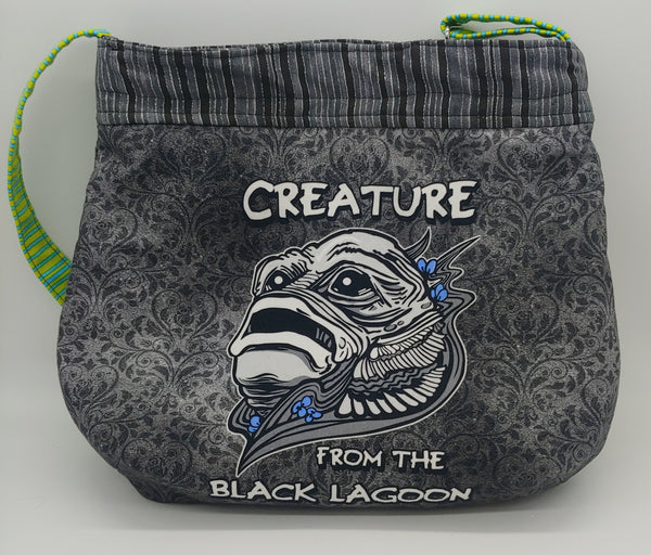 Creature crossbody bag