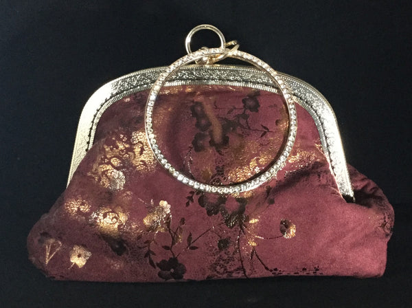 Fancy red clutch with jeweled handle